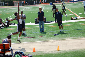 Myles in flight for long jump at Loyola